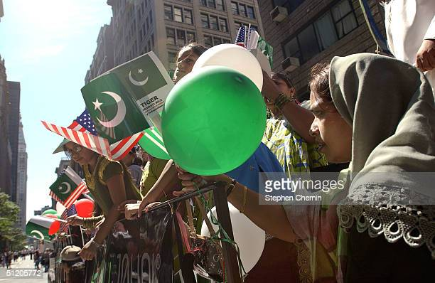 Youngsters on a float wave green and white balloons and Pakistani and American flags during the Pakistani Day Parade August 22 2004 in New York City