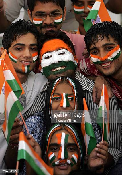Youngsters paint their faces in TriColour at Trinity Corner Beauty Parlour at Girgaum on the eve of Republic Day