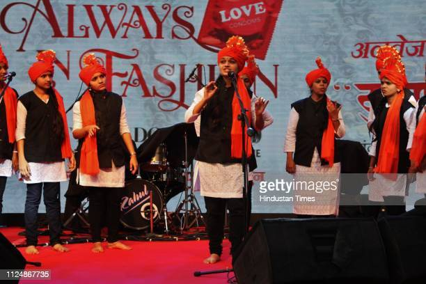 Youngsters perform a cultural programme during a drive to increase awareness about condoms as a contraceptive method, at Shivaji Maidan in Jambli...