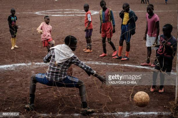 Youngsters play football before their match during the HIV prevention event for youth organized by nongovernmental organisation 'I Choose Life...