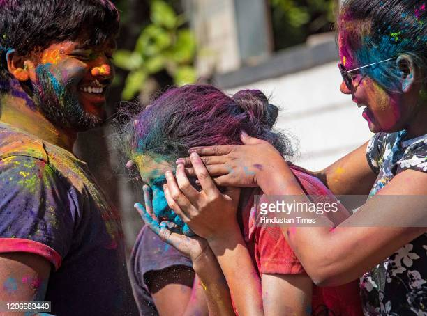Youngsters play with the colors on the occasion of Dhulwad at Kothrud on March 10 2020 in Pune India