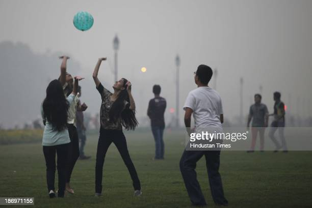 Youngsters playing during the foggy weather on November 5 2013 in New Delhi India The Met Office has forecast a cloudy day The city experienced...