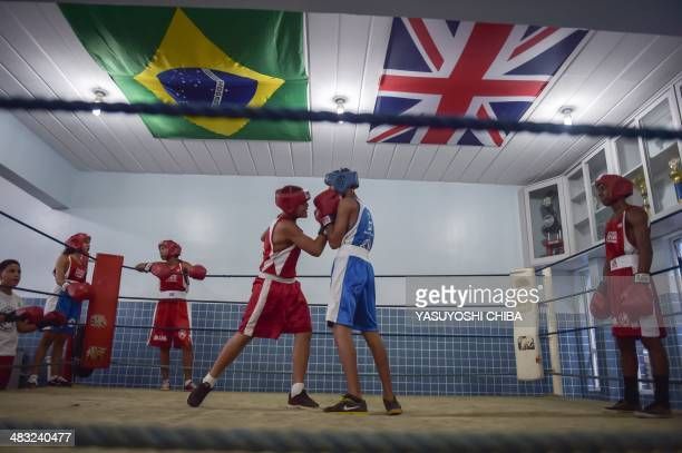 Youngsters practice boxing during British Finance Minister George Osborne's visit to the Fight for Peace NGO, run by his schoolmate in England Luke...