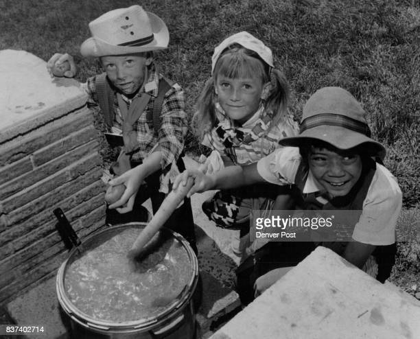 Youngsters Put Vegetables in Hobo Stew 'David Marvin 6135 W Jefferson Place Donna Hail 5590 W Florida Ave and Lucille Lamb 970 S Chase St left to...