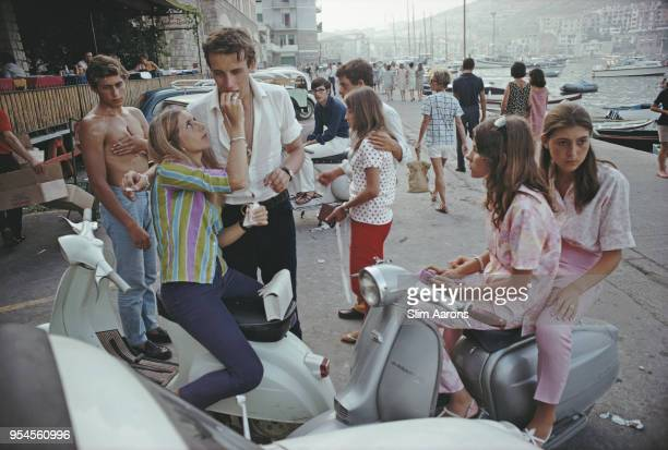 Youngsters spending time together near the seafront of Porto Ercole, Tuscany, Italy, 1967.