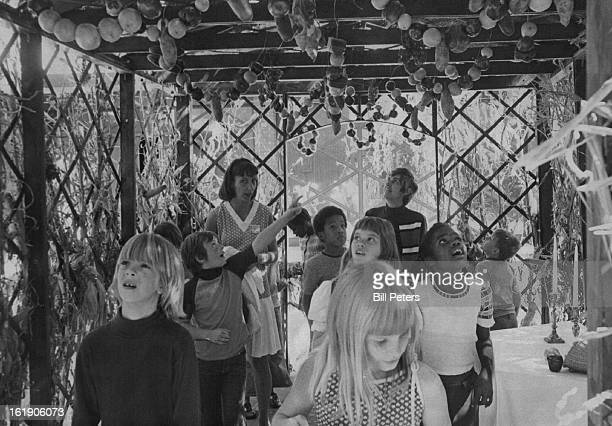 Youngsters take tour through the sukkah, the booth built outside temples during holiday of Sukkoth, the festival of fall harvest.;