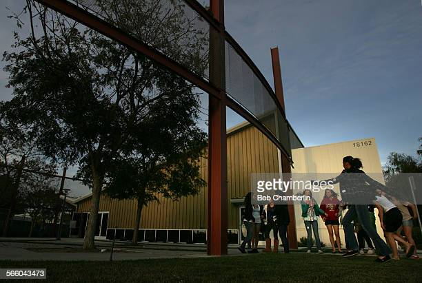 Youngsters wait for Bible study class to start in front of the main sanctuary on the campus of Seabreeze Church on April 28, 2010. In 2004 the church...