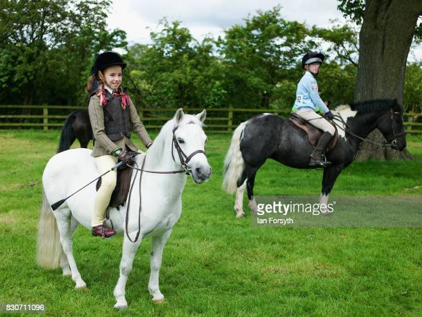 Youngsters wait with their ponies in an exercise arena before competing during the 194th Sedgefield Show on August 12 2017 in Sedgefield England The...