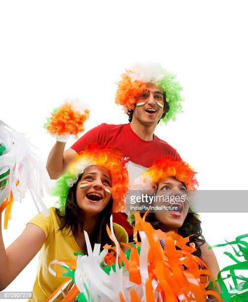 Youngsters with wigs cheering