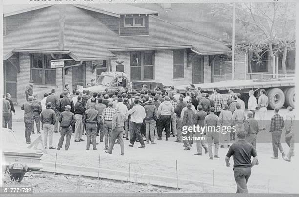 An empty steel hauler leaves the plant of Youngstown Sheet Tube in Campbell and a mass of pickets rush in to stop it The driver was hit by a picket...