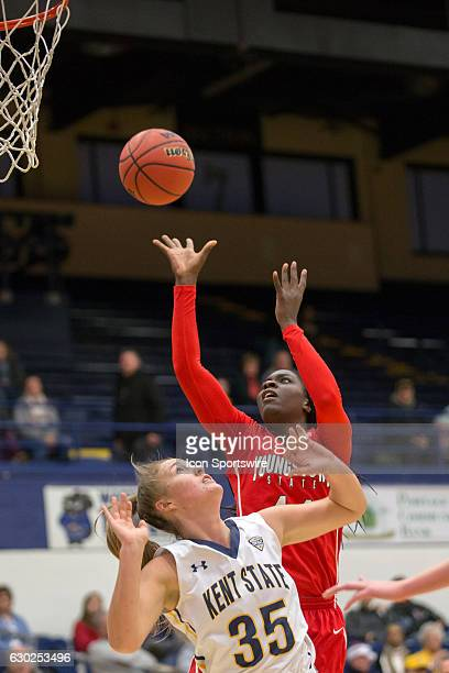 Youngstown State Penguins F Tamira Ford shoots over Kent State Golden Flashes F Jordan Korinek during the first quarter of the NCAA Women's...
