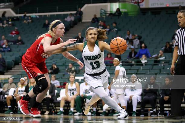 Youngstown State Penguins forward Sarah Cash and Cleveland State Vikings guard Mariana Bautista battle to rebound a missed foul shot during the...