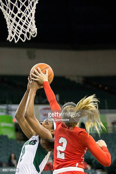 Youngstown State Penguins G Alison Smolinski blocks the chot of Cleveland State Vikings F Ashanti Abshaw during the first quarter of the NCAA Women's...