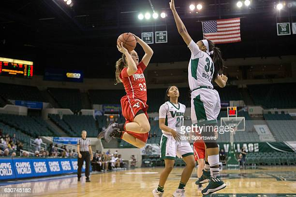 Youngstown State Penguins G Jenna Hirsch goes up for a shot as Cleveland State Vikings F Shadae Bosley defends during the fourth quarter of the NCAA...