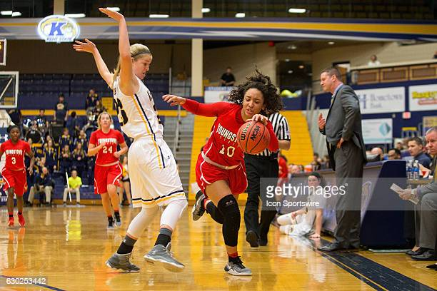 Youngstown State Penguins G Mailee Jones looses her balance after being fouled by Kent State Golden Flashes G Ali Poole during the second quarter of...