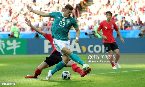 Youngsun Yun of Korea Republic tackles Mario Gomez of Germany during the 2018 FIFA World Cup Russia group F match between Korea Republic and Germany...