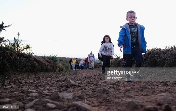 Youngters head up the side of the hill during a procession to the top of the Eston Hills on October 24 2015 in Eston Cleveland The event was...