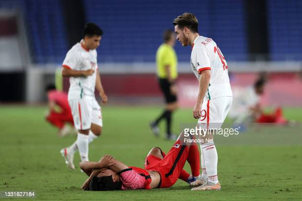 Youngwoo Seol of Team South Korea looks dejected as he is consoled by Ricardo Angulo of Team Mexico following the Men's Quarter Final match between...