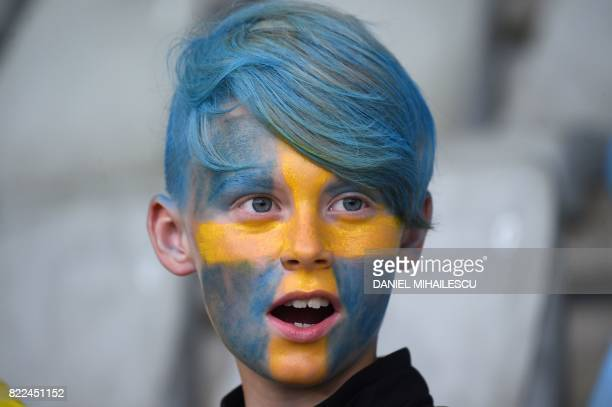TOPSHOT A younh Sweden supporter cheers ahead of the UEFA Women's Euro 2017 football match between Sweden and Italy at the Stadion De Vijverberg in...