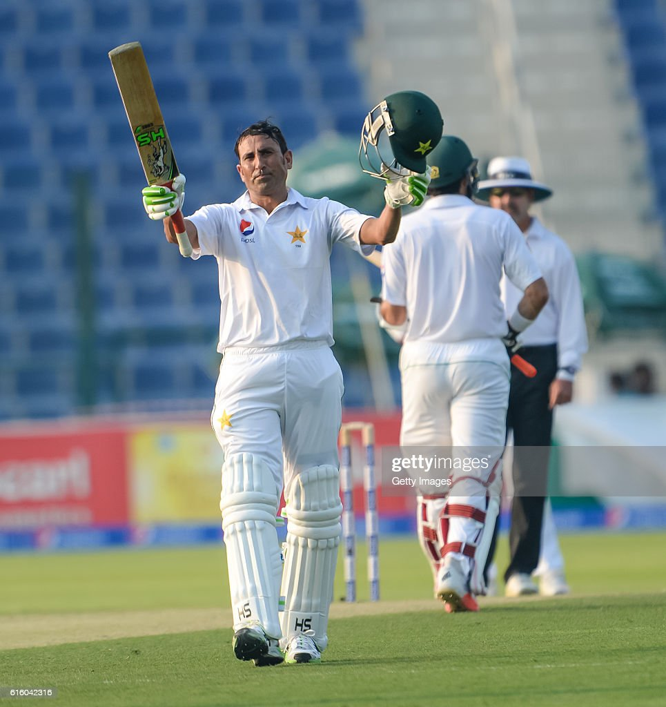 Younis Khan celebrates his century during Day One of the Second Test between Pakistan and the West Indies at the Zayed Cricket Stadium on October 21, 2016 in Abu Dhabi, United Arab Emirates.