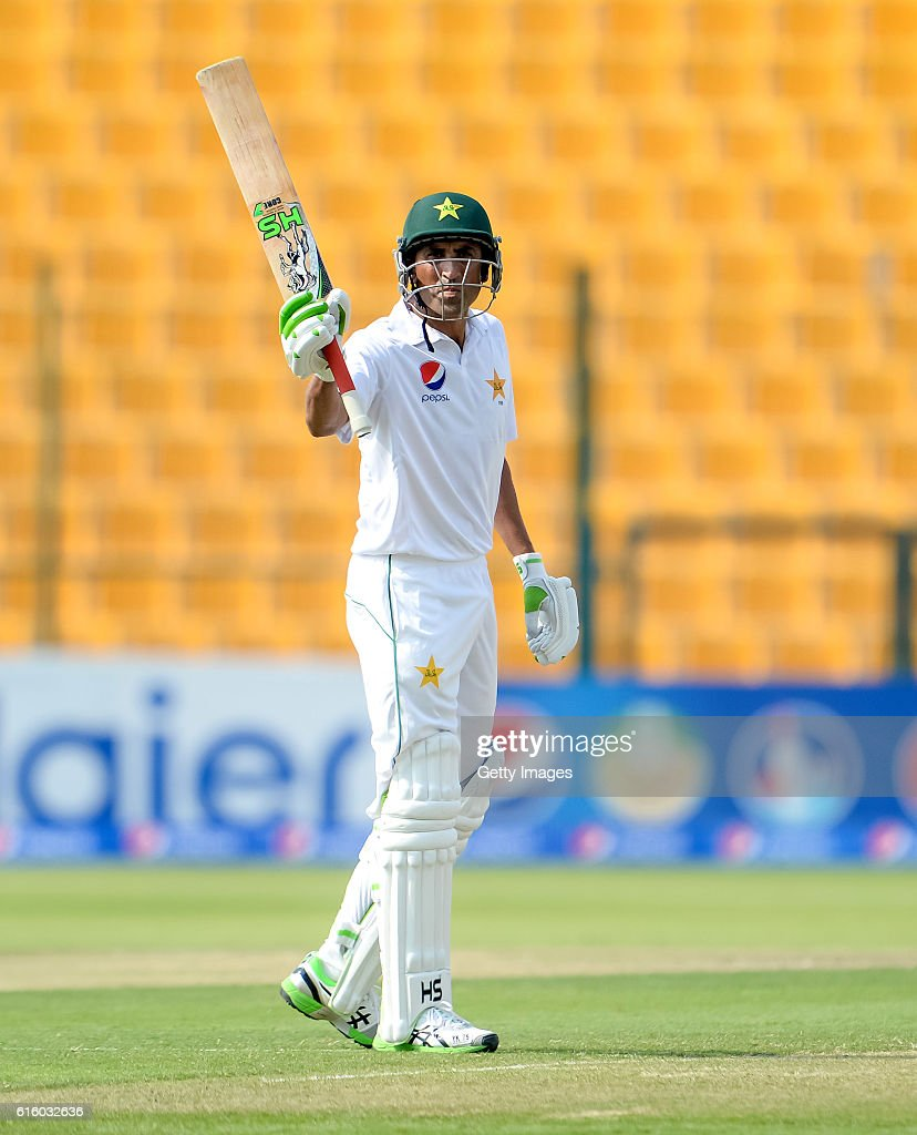 Younis Khan celebrates his half century during Day One of the Second Test between Pakistan and the West Indies at the Zayed Cricket Stadium on October 21, 2016 in Abu Dhabi, United Arab Emirates.