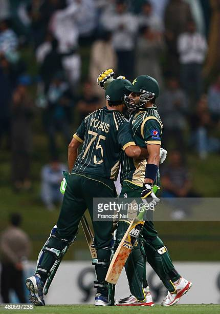 Younis Khan is congratulated by Shahid Afridi after reaching his century during the 4th One Day International match between Pakistan and New Zealand...