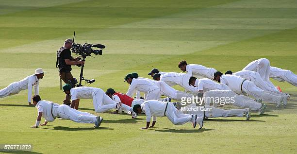 Younis Khan leads the Pakistan team as they perform press ups to celebrate winning the test match on day four of the 1st Investec Test match between...