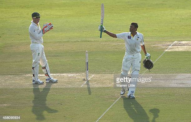 Younis Khan of Pakistan acknowledges the crowd after reaching his century during day one of the second test between Pakistan and Australia at Sheikh...