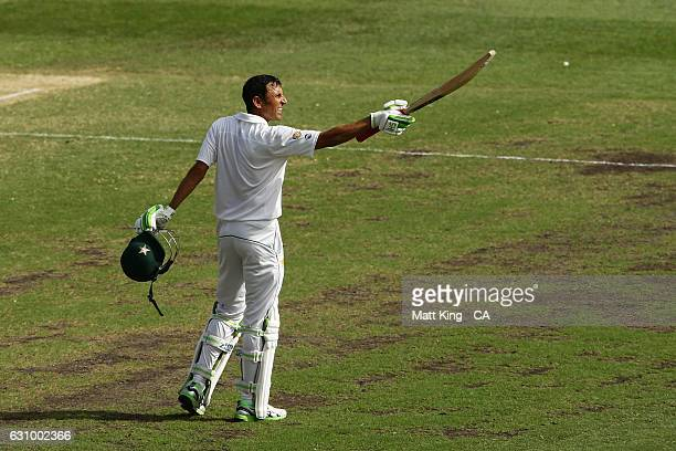 Younis Khan of Pakistan celebrates and acknowledges the crowd after scoring a century during day three of the Third Test match between Australia and...
