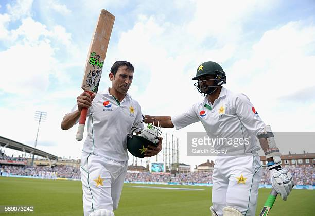 Younis Khan of Pakistan is congratuted by Sohail Khan as he leaves the field after making 218 during day three of the 4th Investec Test between...