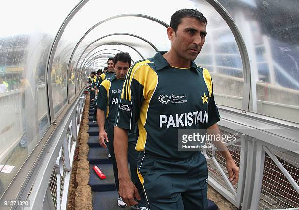 Younis Khan of Pakistan leads his team on to the field for the national anthems ahead of the ICC Champions Trophy 2nd Semi Final match between New...