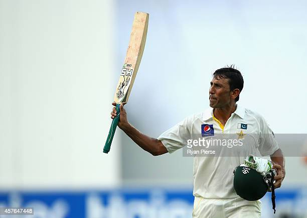 Younis Khan of Pakistan leaves the ground after being dismissed for 106 runs by Mitchell Johnson of Australia during Day One of the First Test...