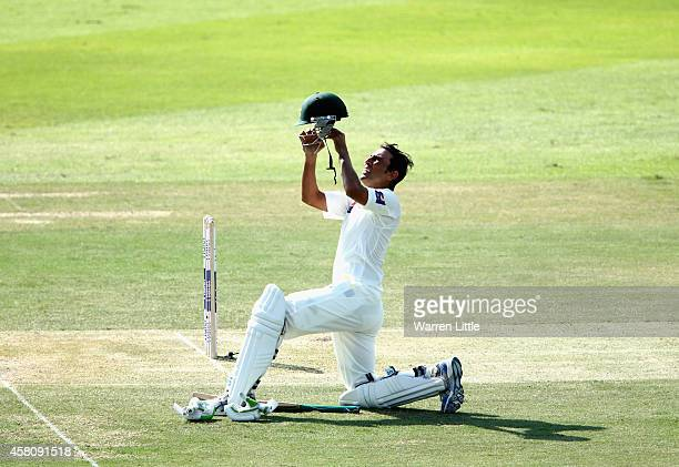 Younis Khan of Pakistan replaces his hemlet during day one of the second test between Pakistan and Australia at Sheikh Zayed stadium on October 30...