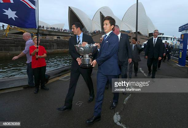 Younis Mahmoud from Iraq and Takashi Fukunishi from Japan carry the AFC Asian Cup trophy ahead of the/during the 2015 AFC Asian Cup draw at Sydney...