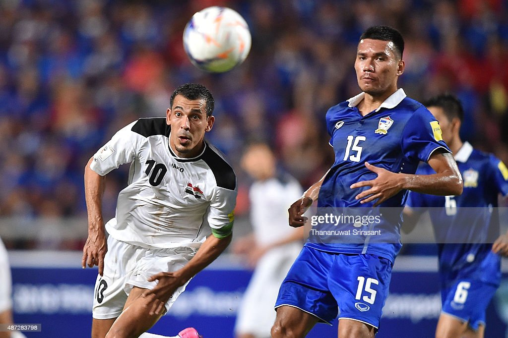 Younis Mahmoud #10 of Iraq (L) and Koravit Namwiset #15 of Thailand (R) looks for the ball during the 2018 FIFA World Cup Qualifier match between Thailand and Iraq at Rajamangala Stadium on September 8, 2015 in Bangkok, Thailand.