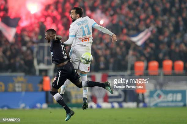 Younousse Sankhare of Bordeaux and Konstaninos Mitroglou of Marseille battle for the ball during the Ligue 1 match between FC Girondins de Bordeaux...