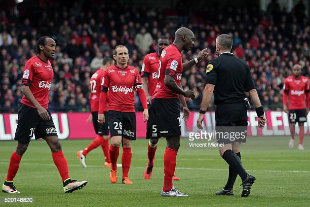 Younousse Sankhare of Guingamp and Fredy Fautrel referee during the French League 1 match between EA Guingamp and Paris SaintGermain on April 9 2016...