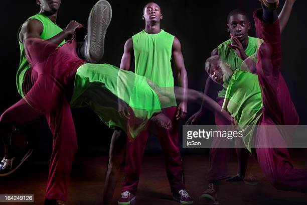 younth man performancing capoeira dance - multiple exposure sport stock pictures, royalty-free photos & images