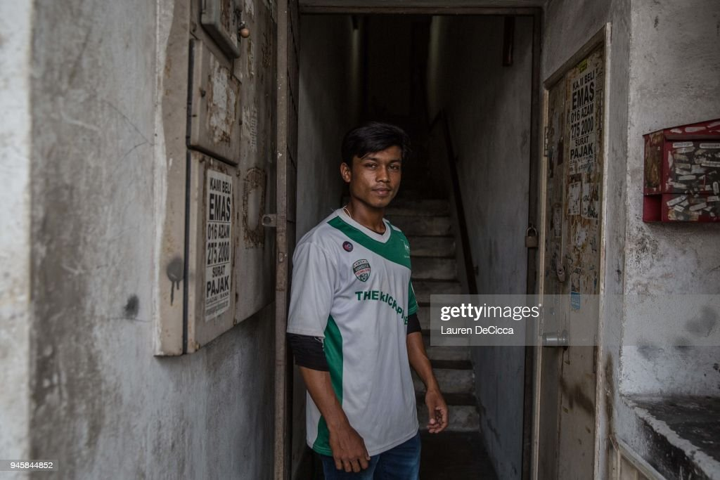 Younus, 18, a member of the Rohingya Football Club, poses for a portrait outside the team's clubhouse on April 8, 2018 in KUALA LUMPUR, Malaysia. Younus came to Malaysia by boat alone in 2013 after his father, who had already been living in Malaysia, heard of the violence in Myanmar's Rakhine State. Younus heard of the Rohingya Football Club while playing with friends he had met in Malaysia and applied for the team. A group of Rohingya refugees from Myanmar's Rakhine State formed the Rohingya Football Club in Malaysia back in 2015, hoping to give the Rohingya people a voice through sports and raise their international profile amidst the crisis in the region. Rohingya Muslims are reportedly playing in Football Clubs around the world, including Canada, Australia, and Ireland, while the Rohingya F.C. aims to set up a national team which comprises of these players and show that Rakhine Muslims can succeed in the sport. The United Nations estimate that over 62 thousand Rohingya are currently living in Malaysia and most of them are only able to find jobs as a construction worker or laborer with many staying in makeshift homes near construction sites. Malaysia launched its first Rohingya tournament this year with 24 independent football clubs competing across the Muslim country, hoping to gather support from the Malaysian and Turkish governments to help them succeed at an international level. Over 700,000 Muslim Rohingya have crossed the border into Bangladesh since August last year after the Myanmar military launched a brutal crackdown which was described by the United Nations as 'ethnic cleansing' while the two countries continue to negotiate the repatriation of the Rohingya refugees.