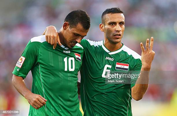 Younus Mahmood of Iraq and Ali Adnan Kadhim of Iraq ceelbrate agoal in extra time during the 2015 Asian Cup match between Iran and Iraq at Canberra...
