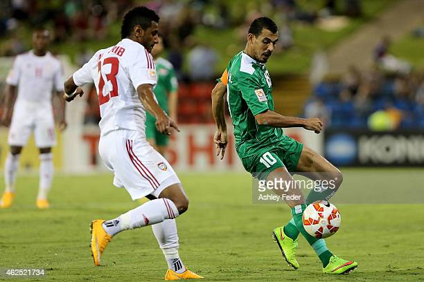 Younus Mahmood of Iraq contests the ball against Mohamed Ahmad Gharib of United Arab Emirates during the Third Place 2015 Asian Cup match between...