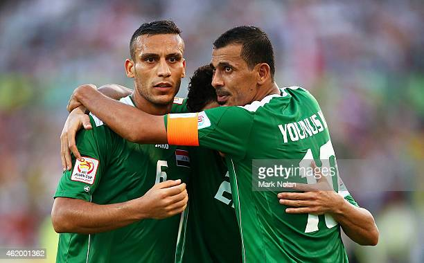 Younus Mahmood Waleed Salim AlLami and Ali Adnan Kadhim of Iraq celebrate a goal in extra time during the 2015 Asian Cup match between Iran and Iraq...