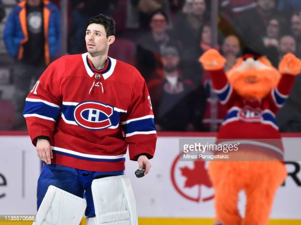 Youppi celebrates in the background as goaltender Carey Price of the Montreal Canadiens looks towards the fans after setting a franchise record with...