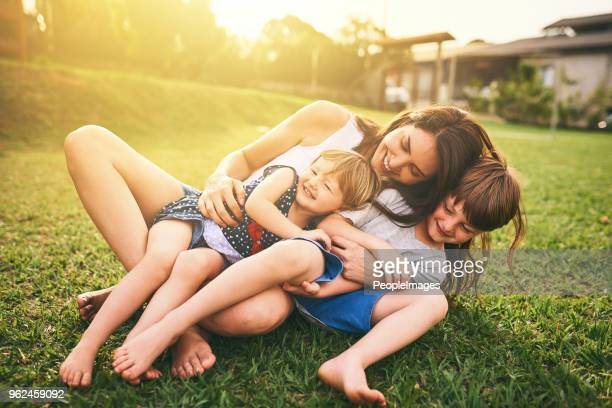 your affection shapes their happiness for life - happy family stock photos and pictures