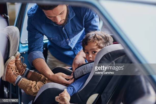your child should always be strapped into their own seat - fastening stock pictures, royalty-free photos & images