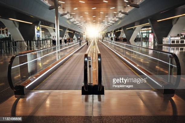 your flight is this way - travolator stock pictures, royalty-free photos & images