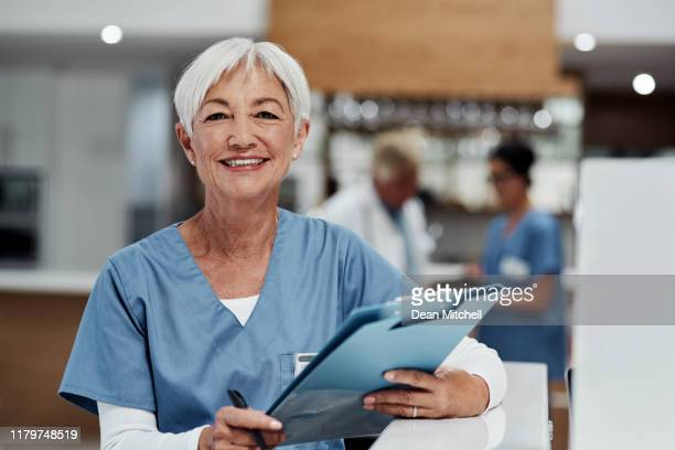 your health is always first on the agenda - female nurse stock pictures, royalty-free photos & images