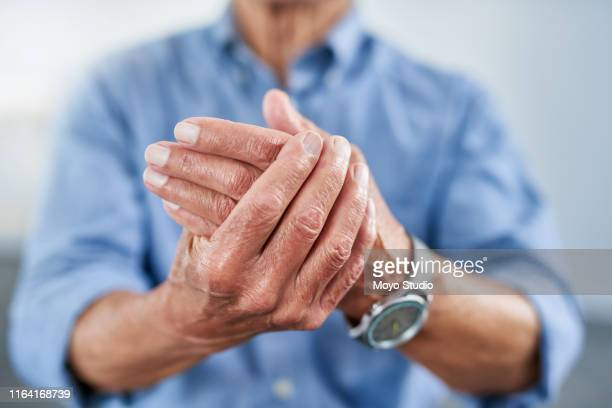 your joints eventually begin to weaken in your latter years - arthritis stock pictures, royalty-free photos & images