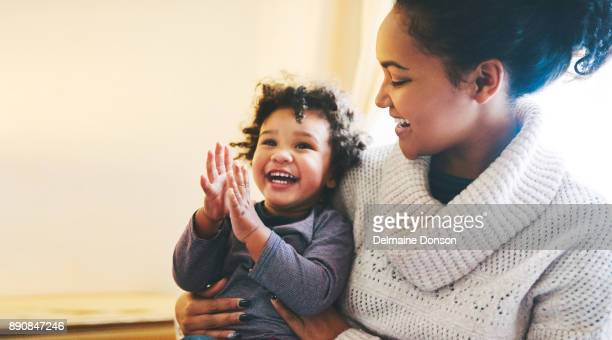 your laugh is the best sound - single mother stock pictures, royalty-free photos & images