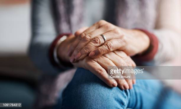 your life is in your hands - hands clasped stock pictures, royalty-free photos & images